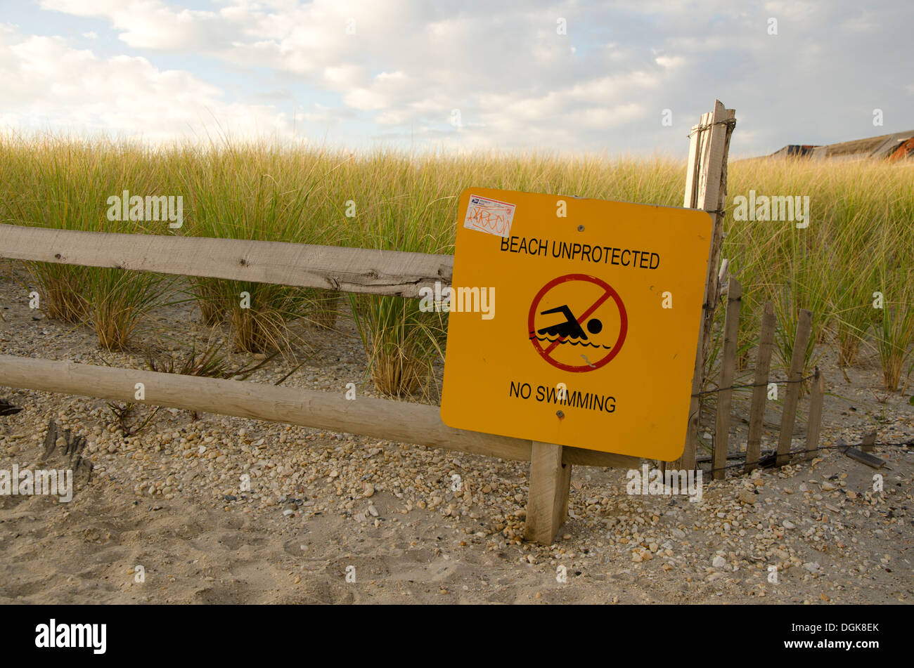 Beach unprotected, no swimming sign. - Stock Image
