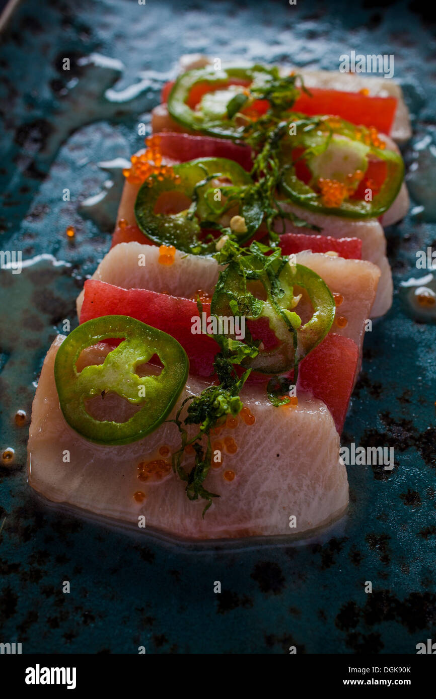 Hawaiian dish with green chilli and garnish - Stock Image