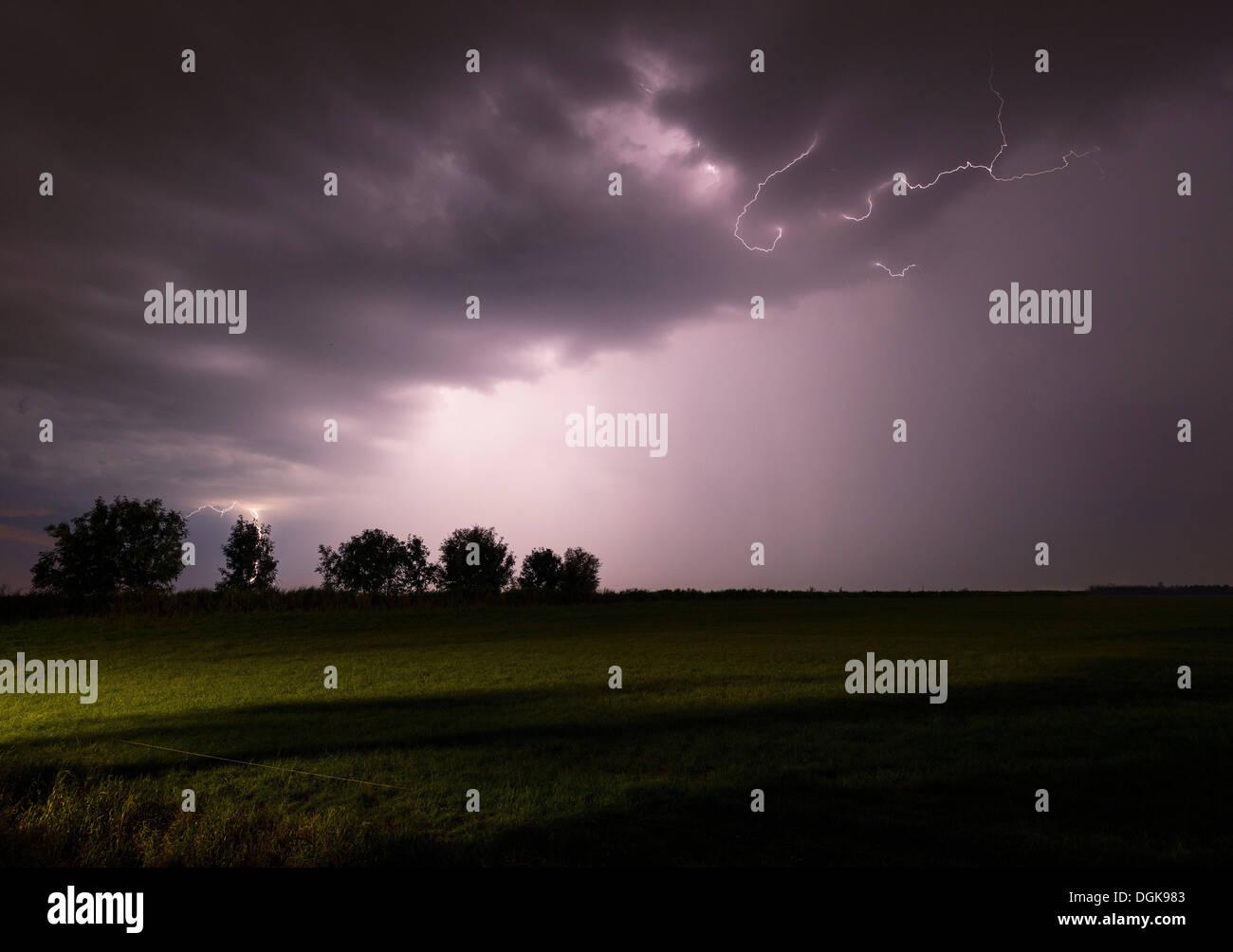 Thunderstorm raging over night sky - Stock Image