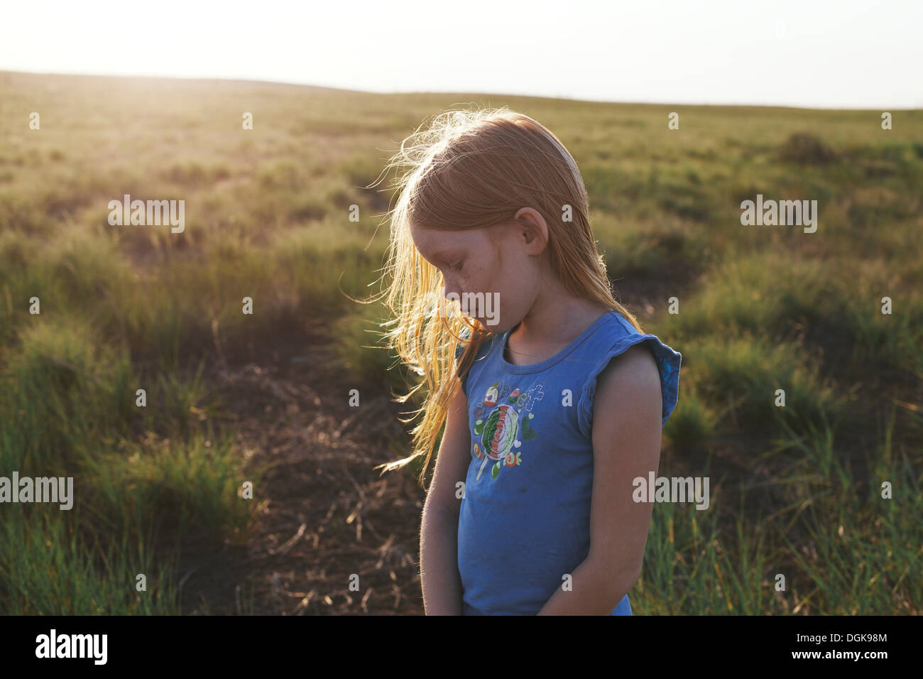 Girl looking down in sadness - Stock Image