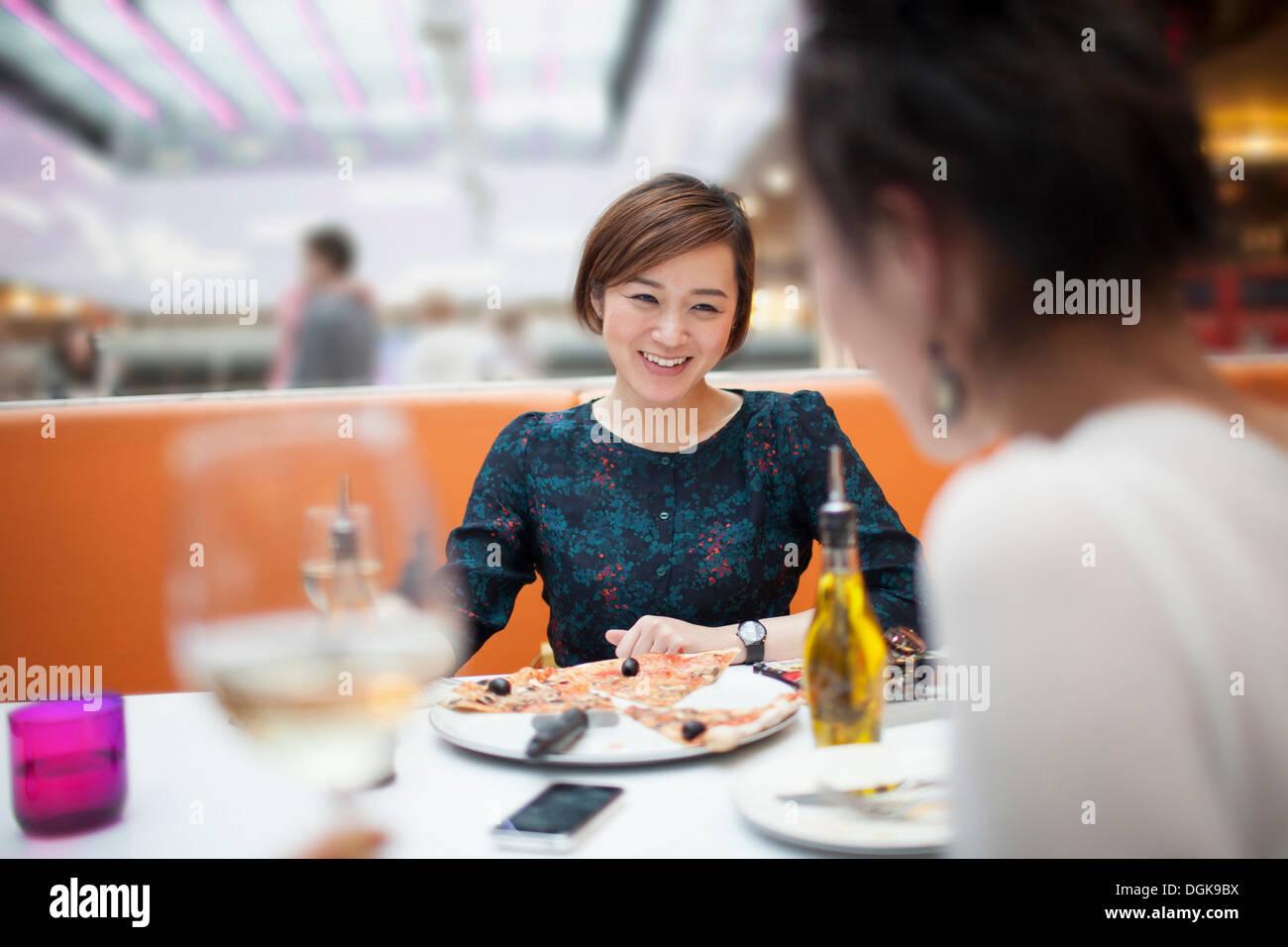 Young women enjoying meal in restaurant Stock Photo