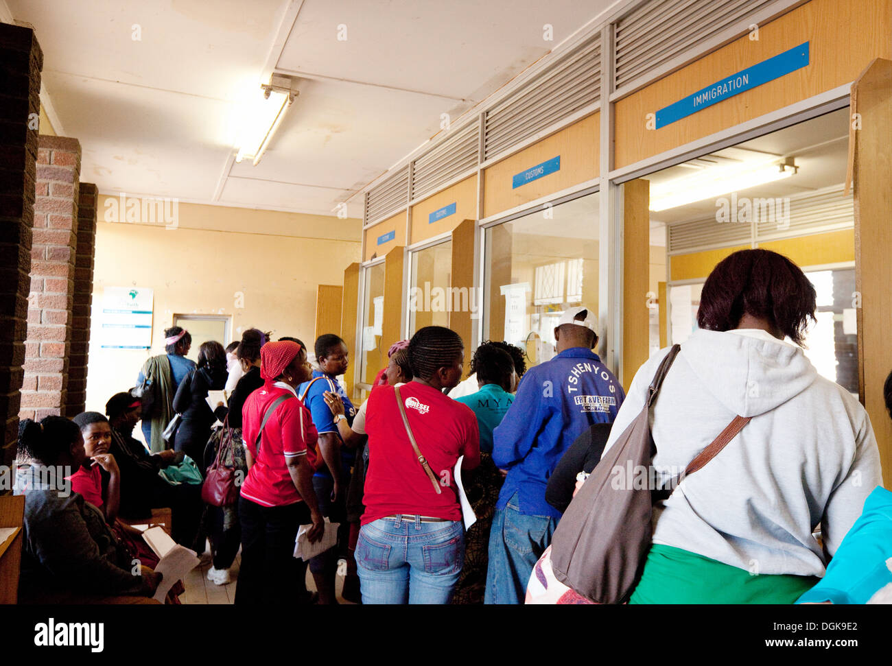 Tourists and local people in the interior of Kazungula Border post, entering Botswana, Africa - Stock Image