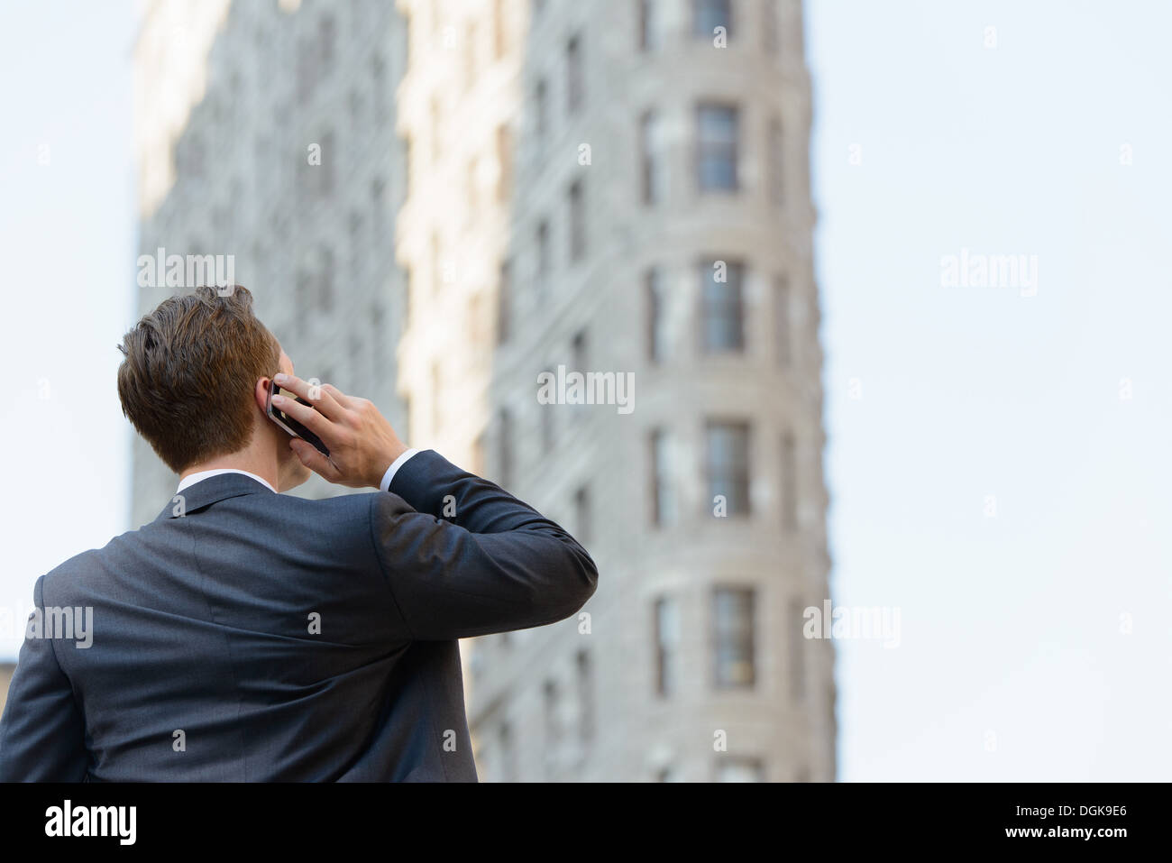 Backview of businessman on mobile phone - Stock Image