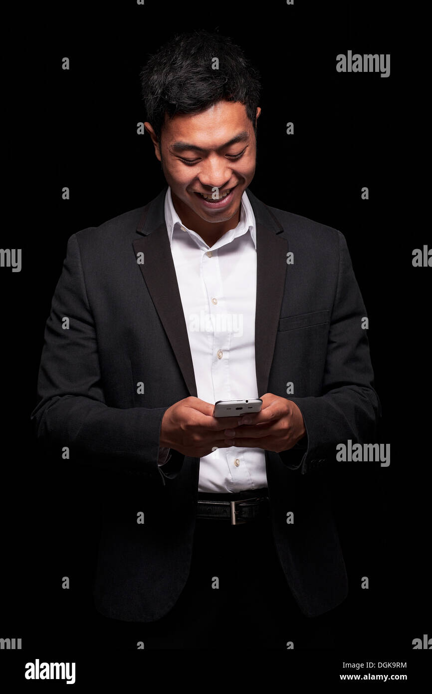 Businessman using smartphone - Stock Image