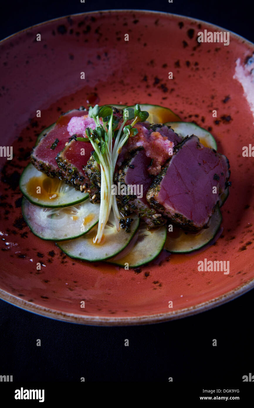 Hawaiian dish with cucumber and garnish - Stock Image