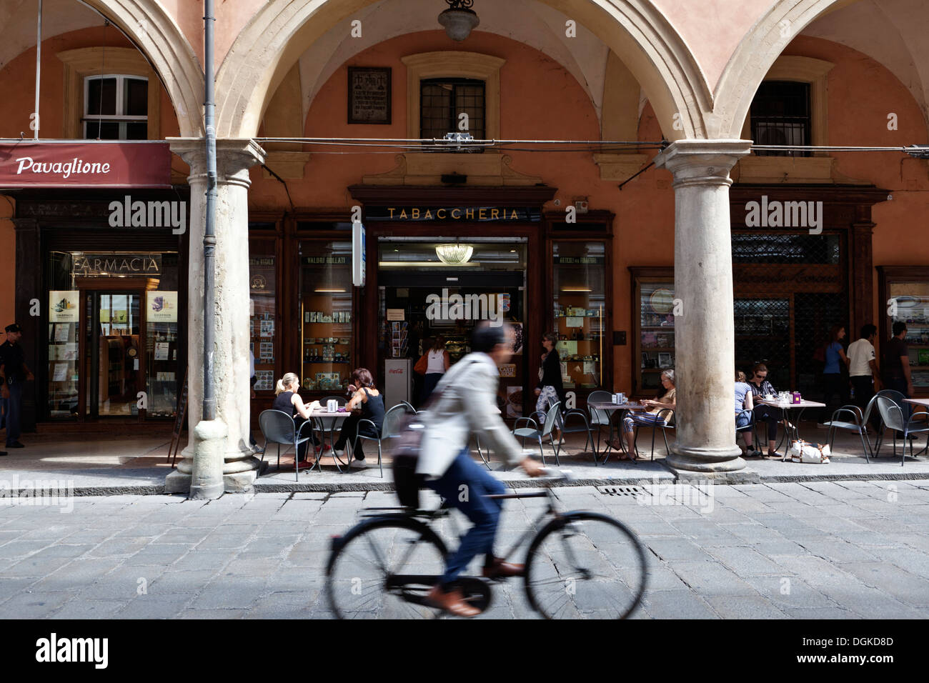 A cyclist passes a tabaccheria in the historical centre of Bologna. Stock Photo