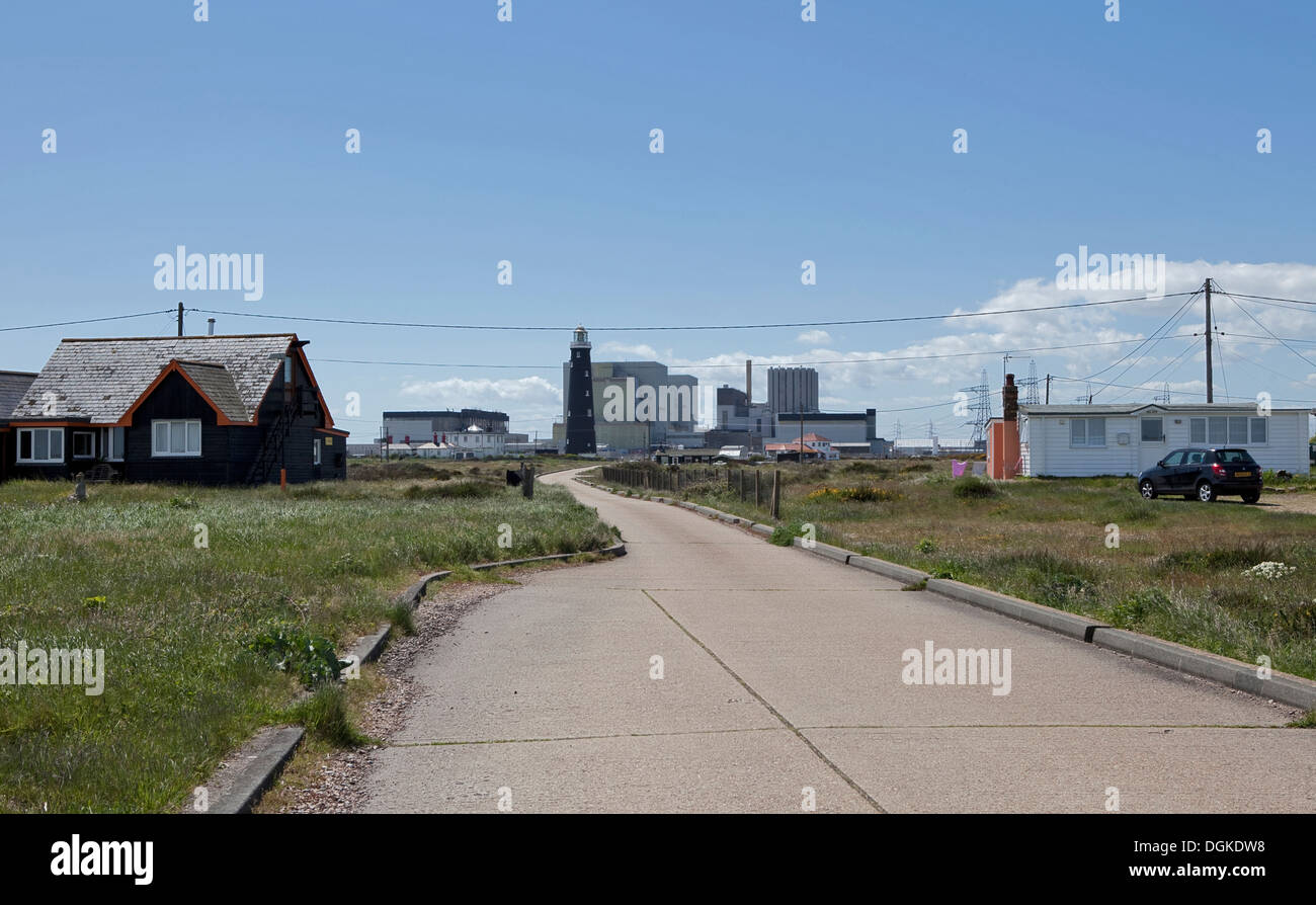 Dungeness Nuclear Power Station , WITH DWELLINGS ON THE ROAD AND ENTRANCE TO POWER STATION - Stock Image
