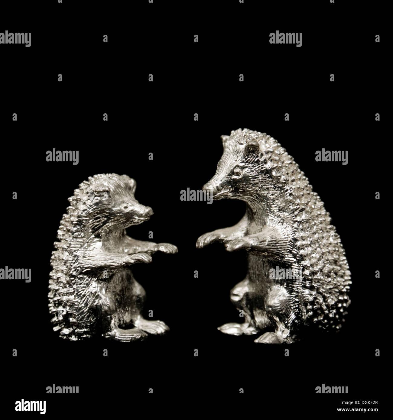 Pair of hedgehog ornaments - Stock Image