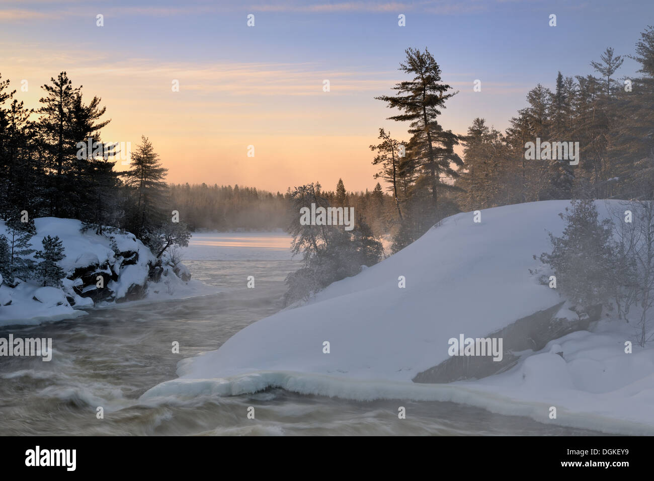 Wanapitei River rapids and frosted pine trees in winter Wanup Ontario Canada - Stock Image