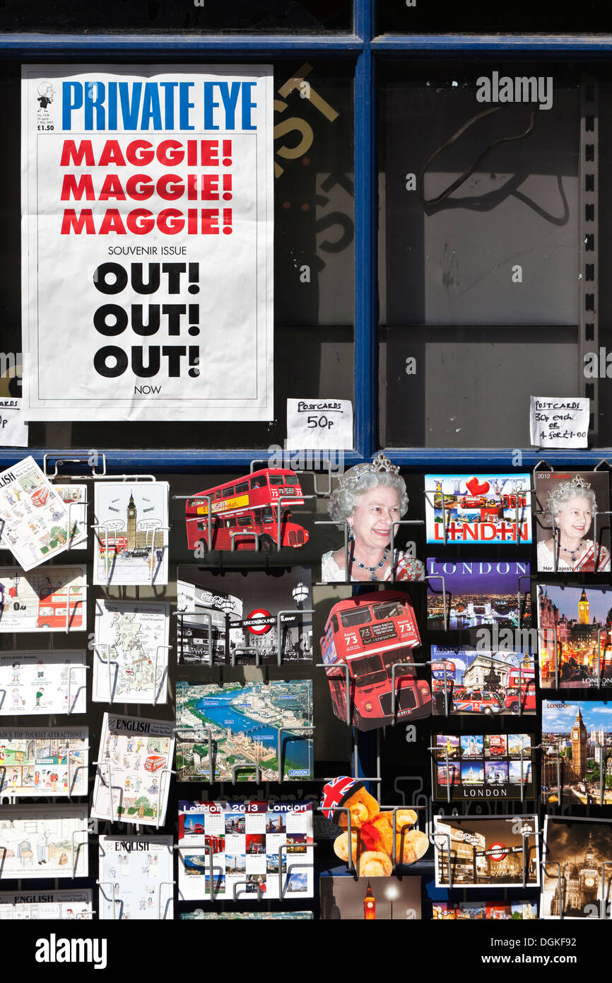 Private Eye poster and London postcards on rack. - Stock Image