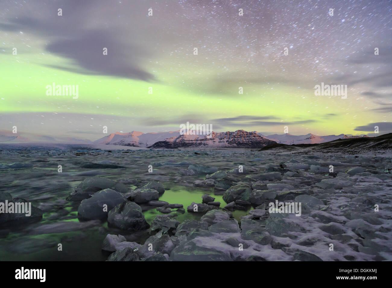 Aurora borealis over the Jokulsarlon Glacier Lagoon in Iceland. Stock Photo