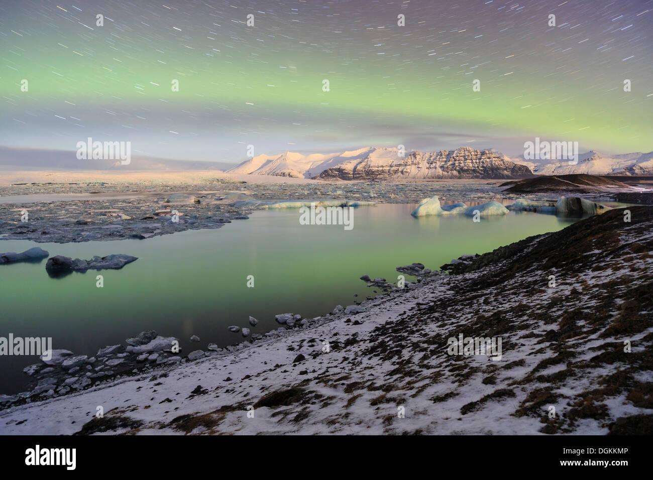 Aurora borealis over the Jokulsarlon Glacier Lagoon in Iceland. - Stock Image