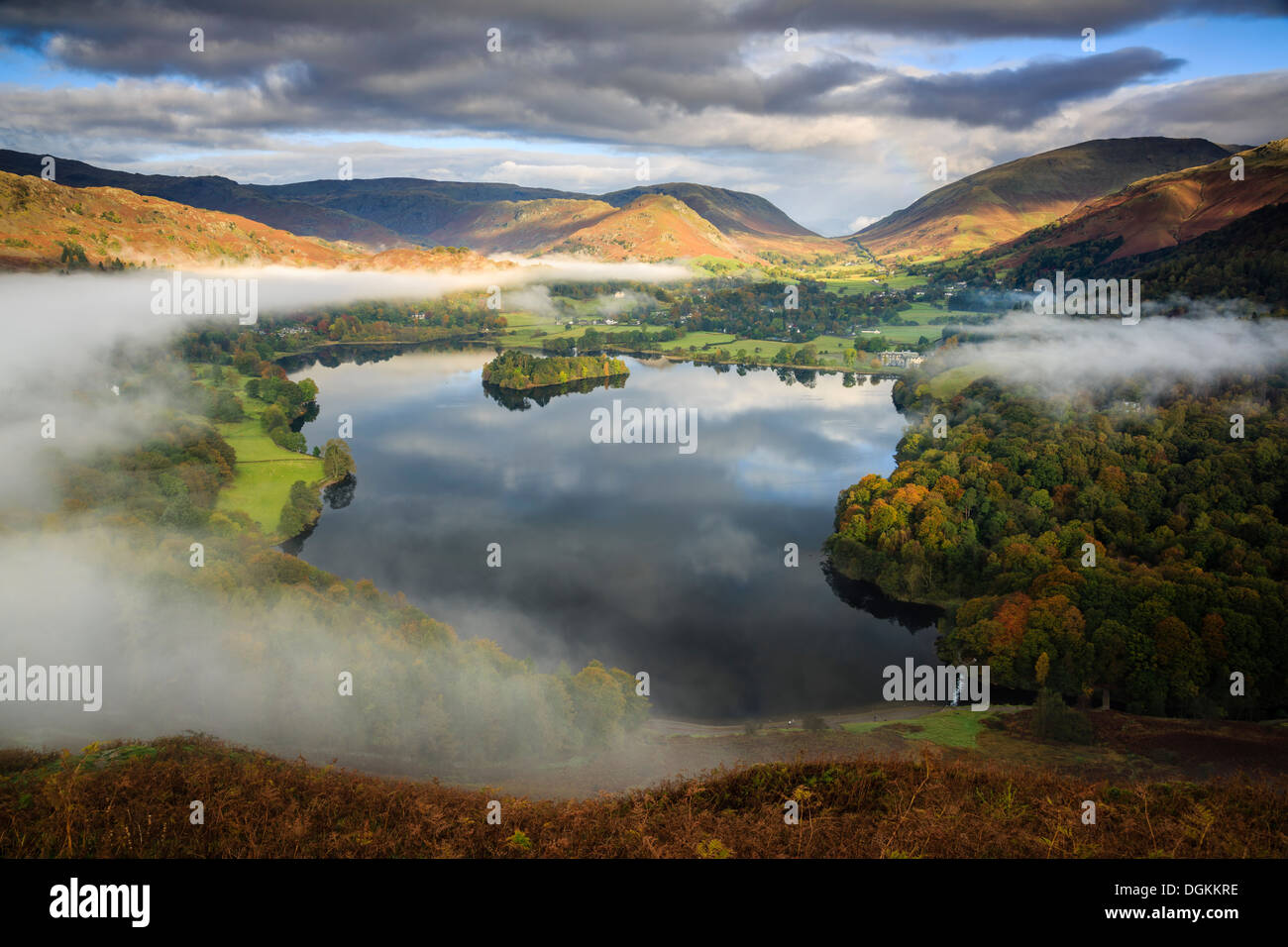 Mist clearing over Grasmere viewed from Loughrigg Hill. - Stock Image