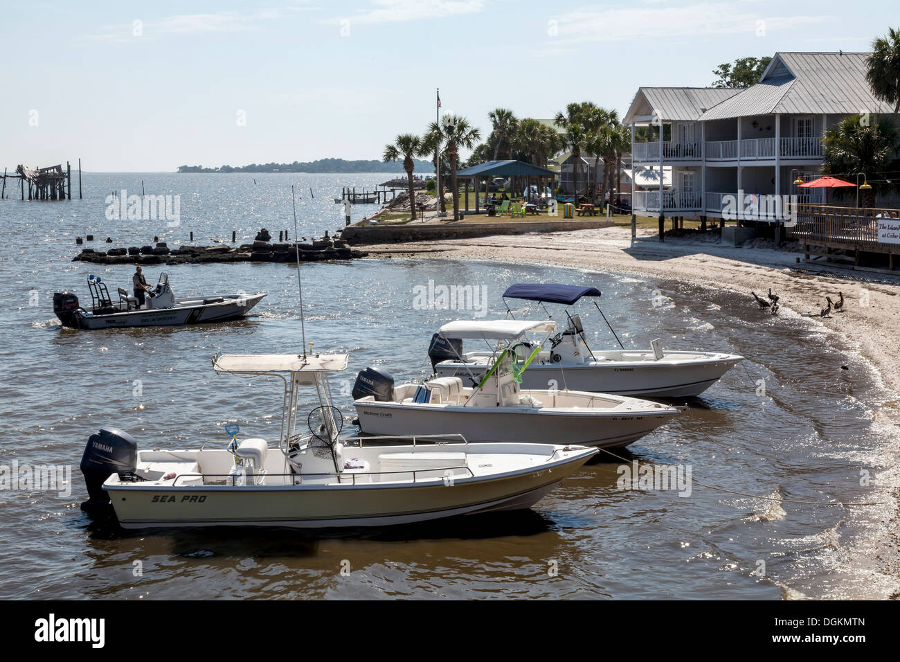 Power fishing boats with canopies anchored beached in Cedar Key along the Gulf coast of Florida. - Stock Image