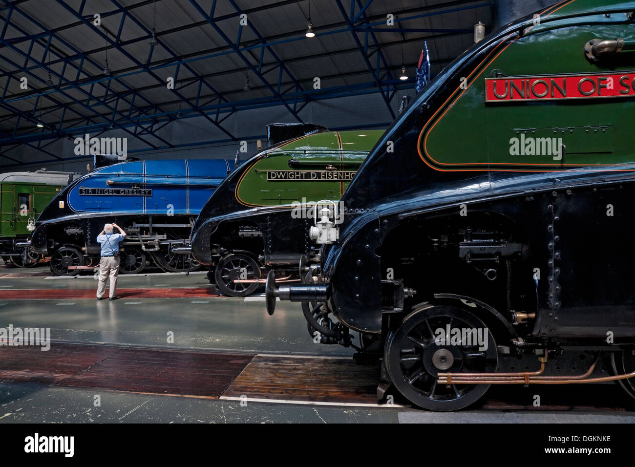 A man photographing one of the A4 Pacific steam locomotives at the National Railway Museum. - Stock Image