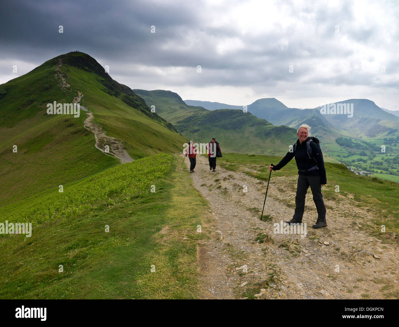 Three walkers on the slopes of Catbells in the English Lake District. - Stock Image
