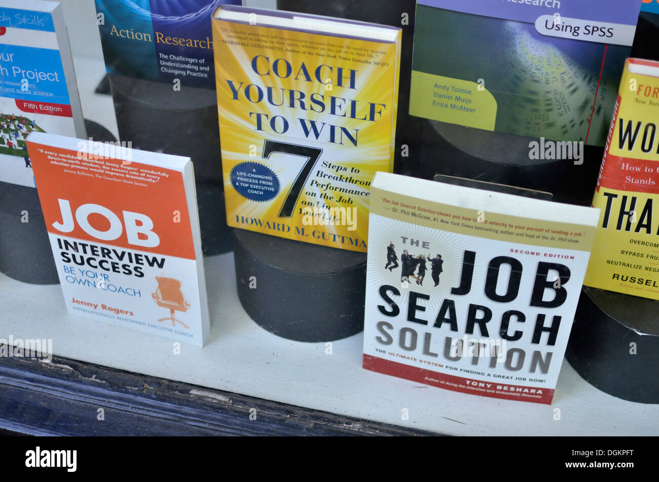 A shop window displaying motivational books aimed at helping to find a job. - Stock Image