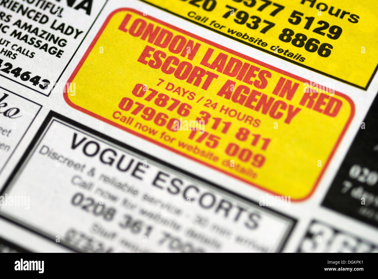 Escort adverts in the classified section of a local newspaper. - Stock Image