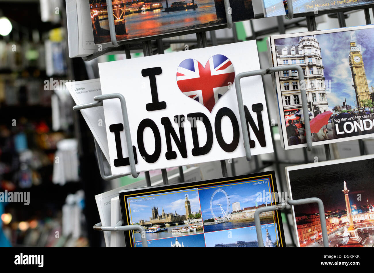 London postcards on a stand outside a souvenir shop. - Stock Image