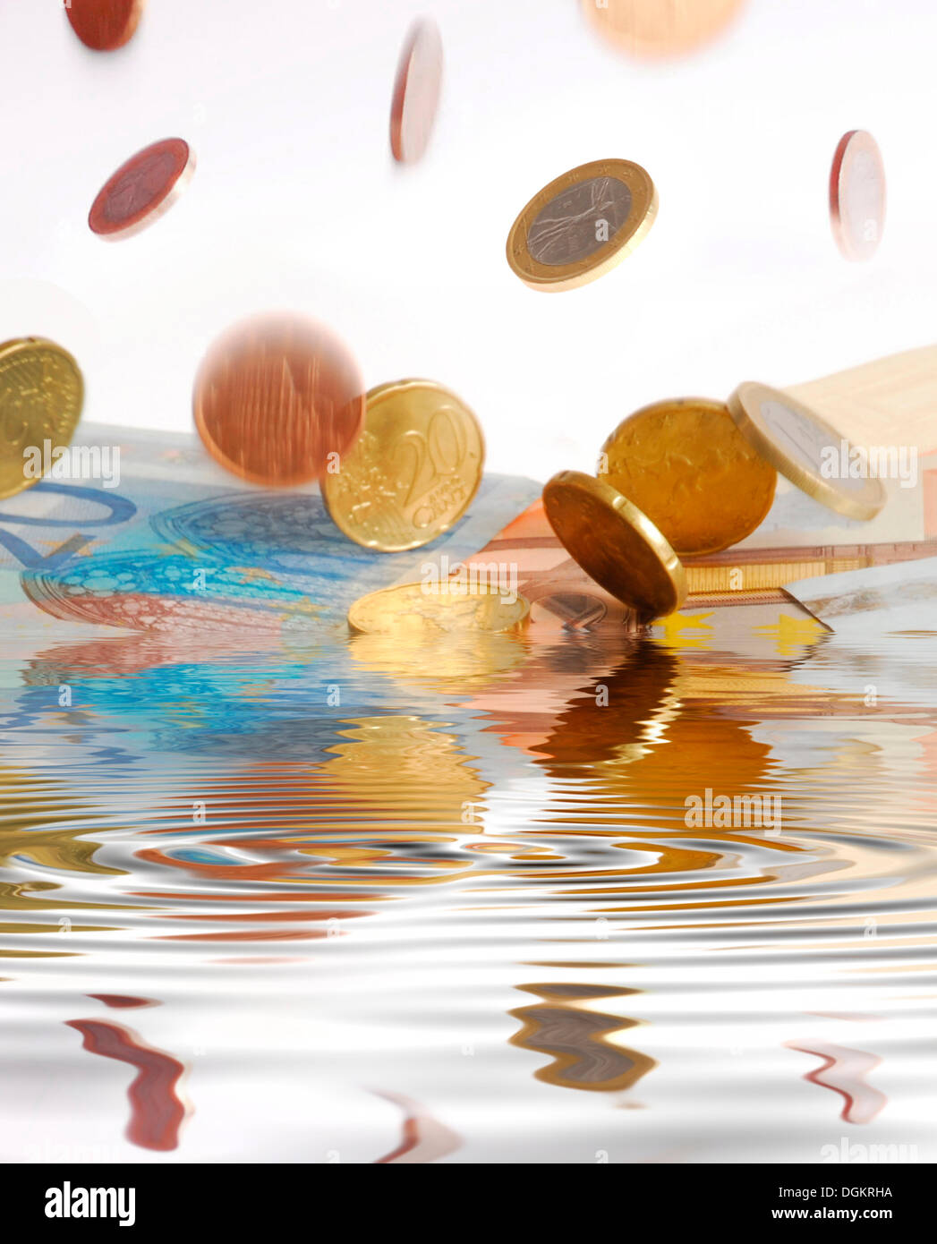 Falling coins, symbolic image for a winfall, falling into water Stock Photo