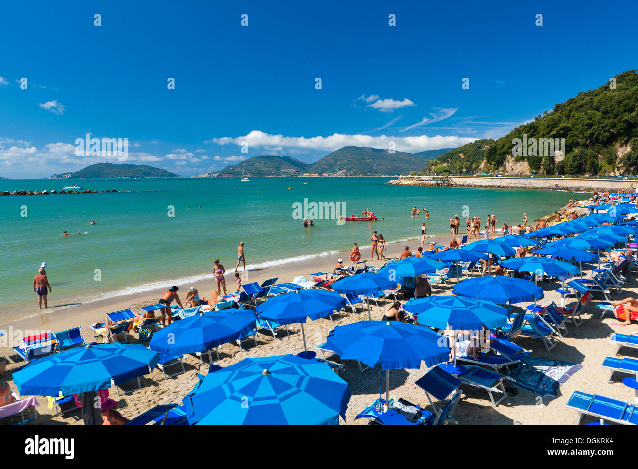 Tourists on the beach at Lerici. - Stock Image