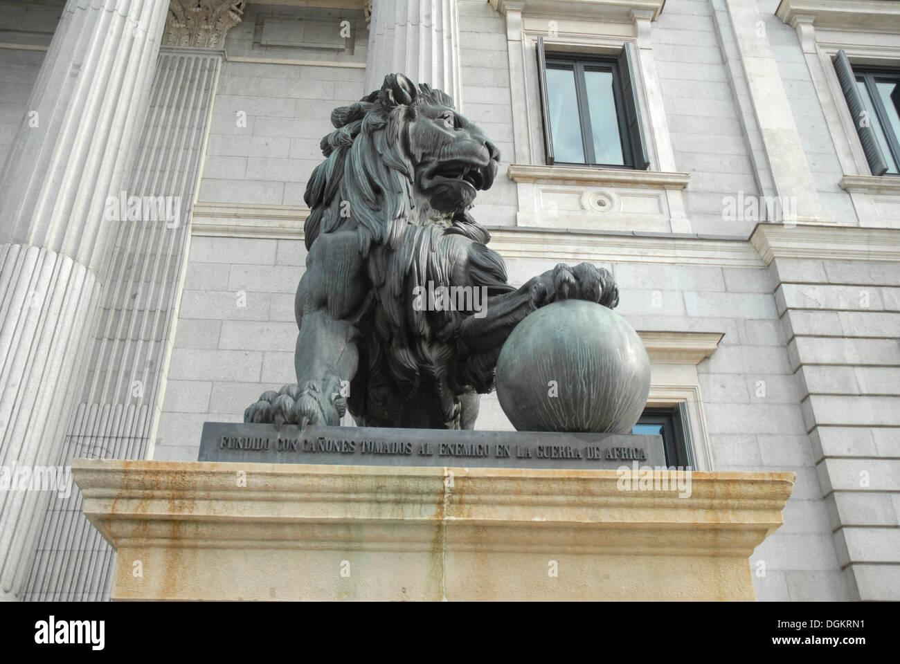 Lion in front of the Congress building, Congreso de los Diputados, Parliament Building, Madrid, Spain, Europe - Stock Image