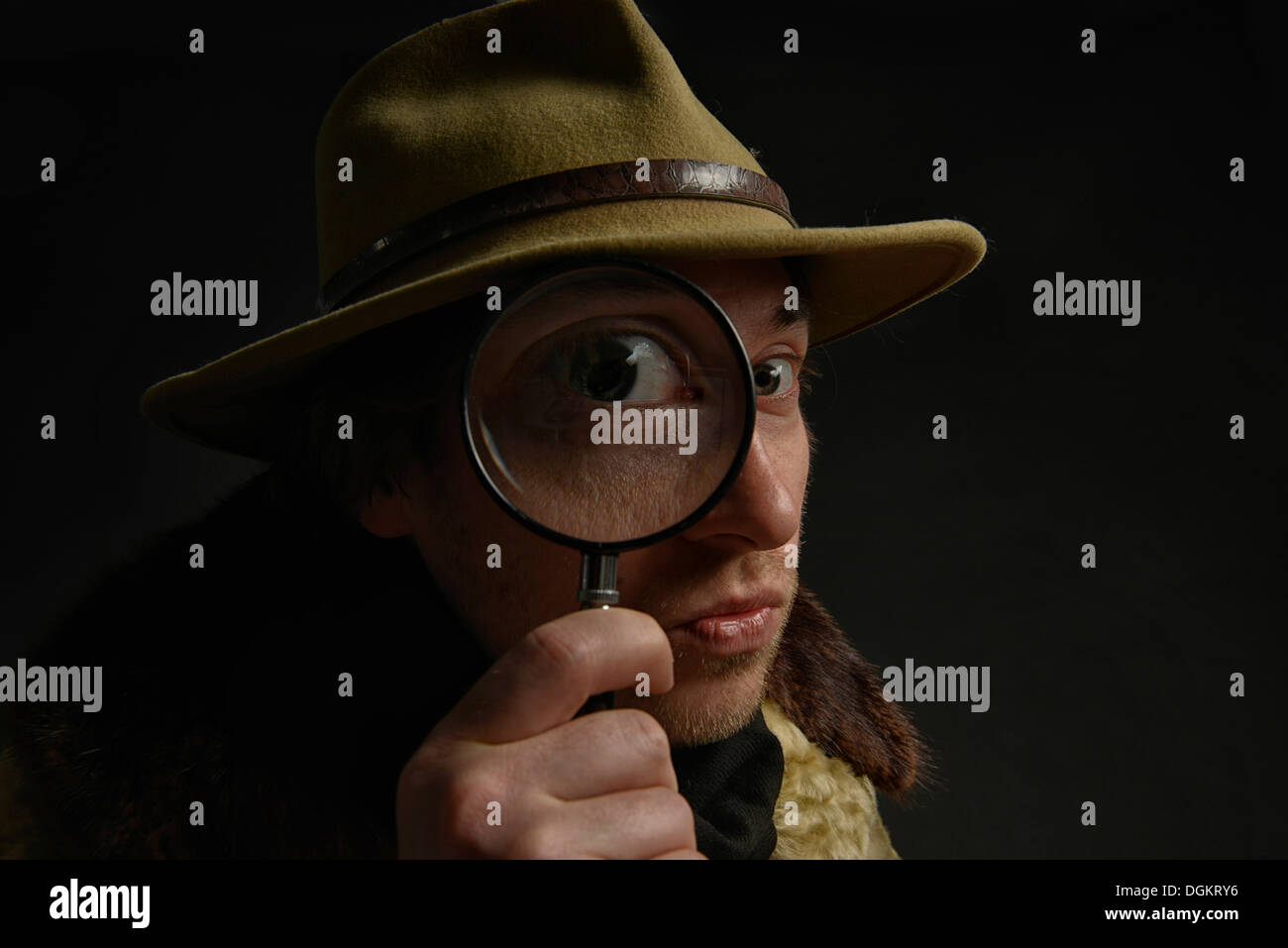 Man holding magnifying glass in front of his eye, Switzerland Stock Photo