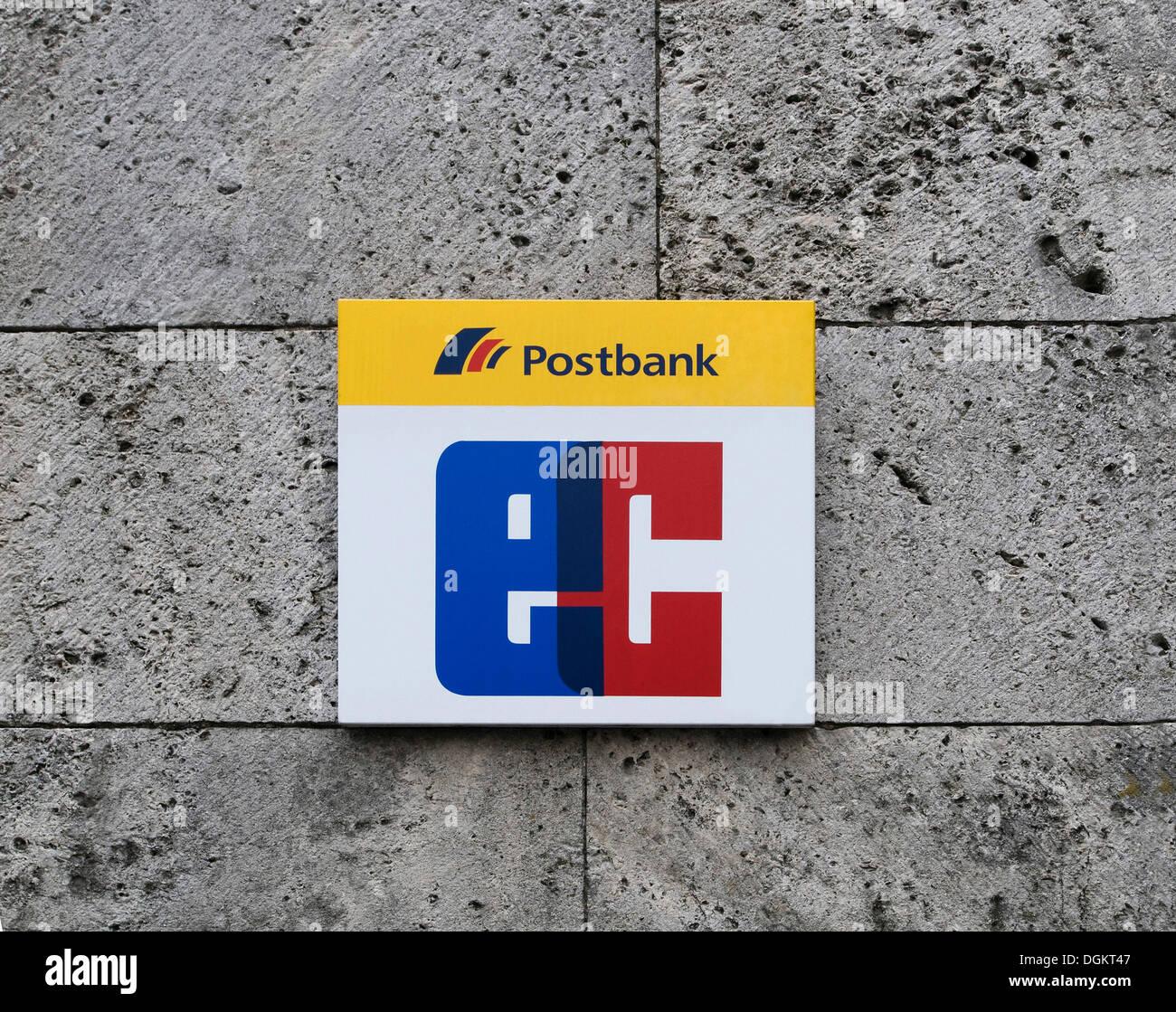 Sign indicating a 'Postbank EC' counter, on a stone facade - Stock Image