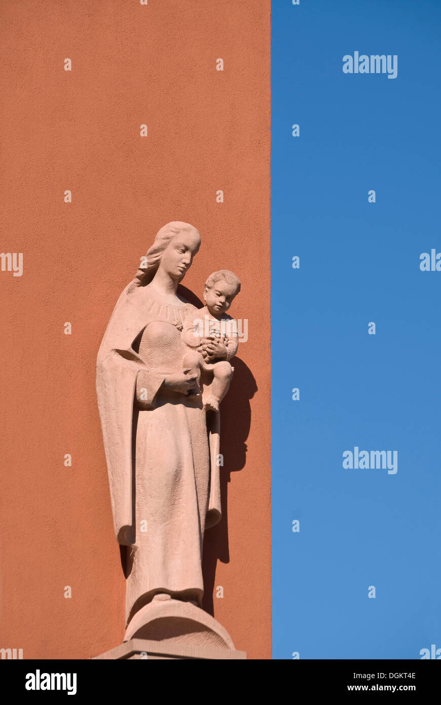 Sandstone statue of Mary with Jesus - Stock Image