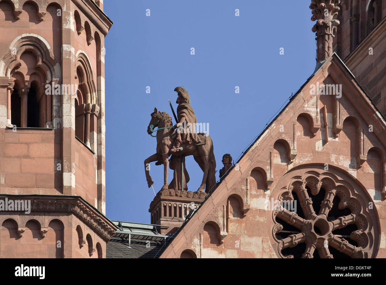 Sculpture of the patron saint of St. Martin on the western roof between the towers, Cathedral of St. Martin, Mainz - Stock Image