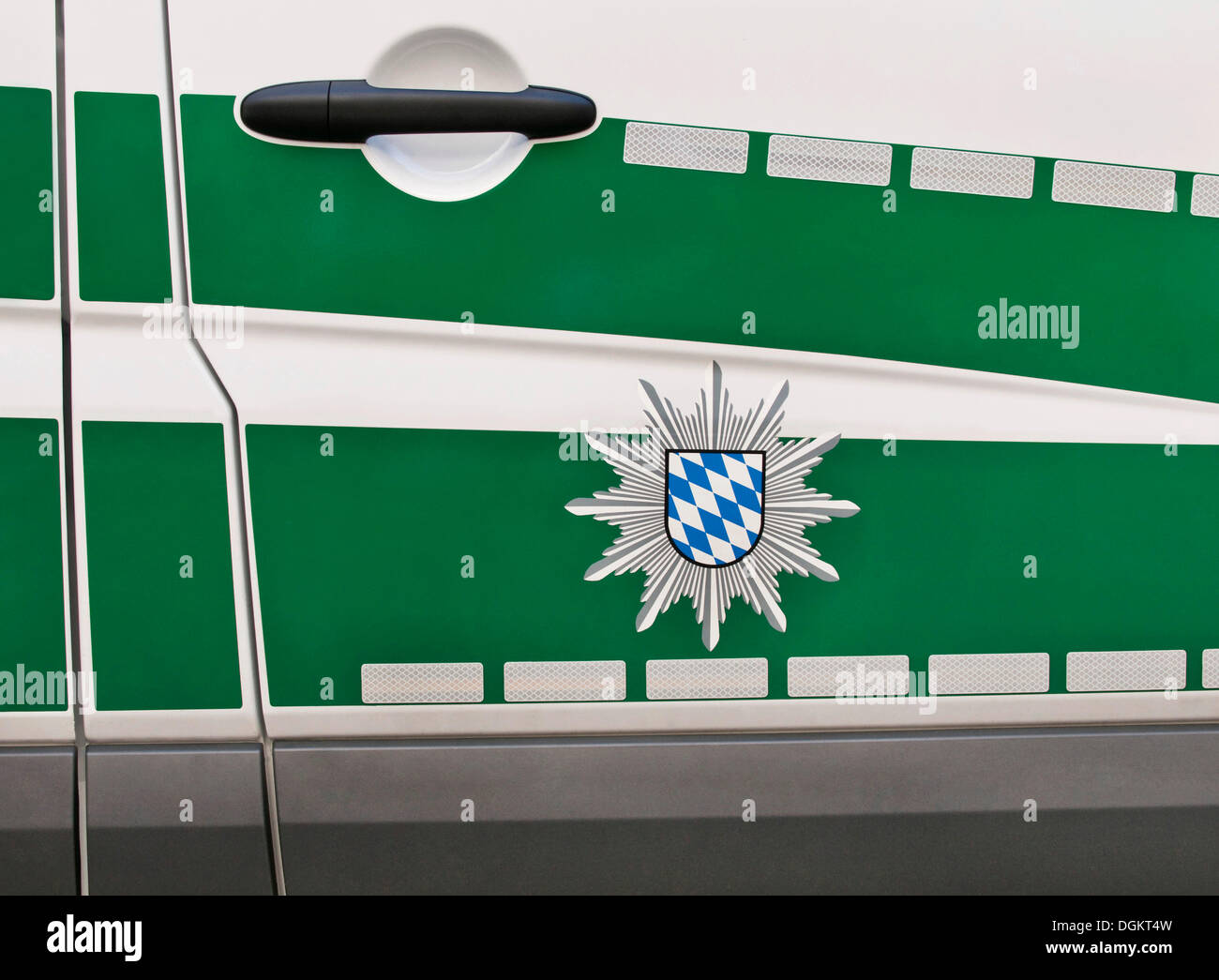 Bavarian police badge on a green police car - Stock Image
