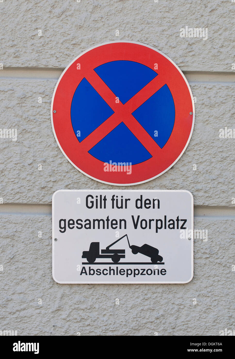 Prohibition sign, absolute parking prohibition applies to the entire square, tow-away zone with a pictogram of a - Stock Image