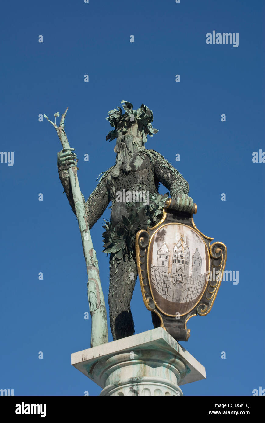 Bronze statue from the Neptune Fountain, a wild man bearing a trident and the coat of arms of Salzburg - Stock Image