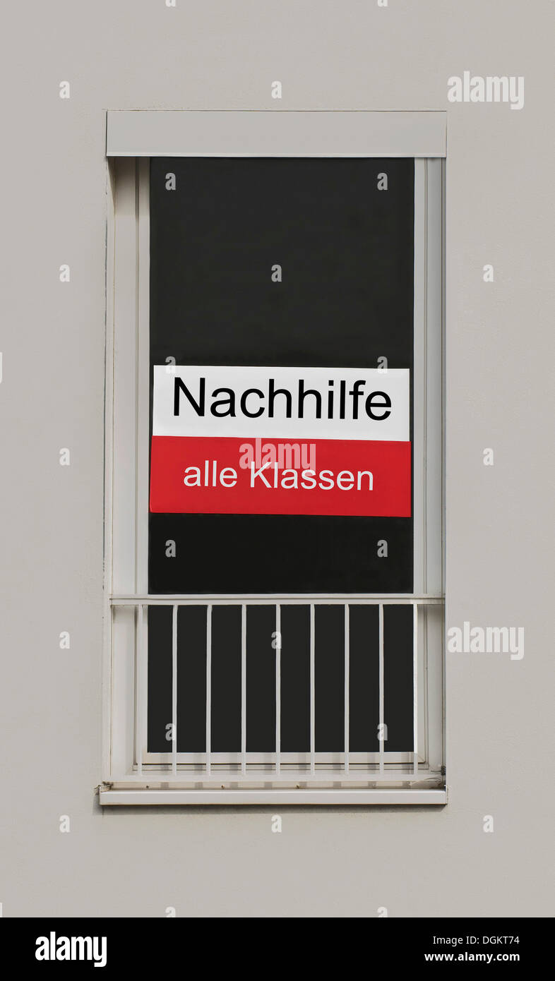 Sign on a window, Nachhilfe alle Klassen, German for tutoring for all classes - Stock Image