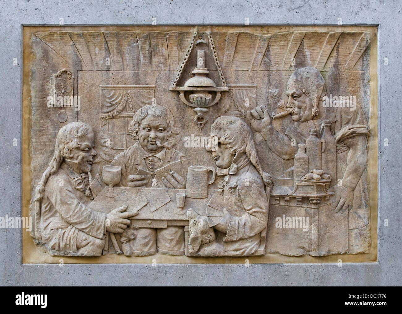 Stone carving, three happy card players and a patron in a tavern, Koblenz, Rhineland-Palatinate - Stock Image