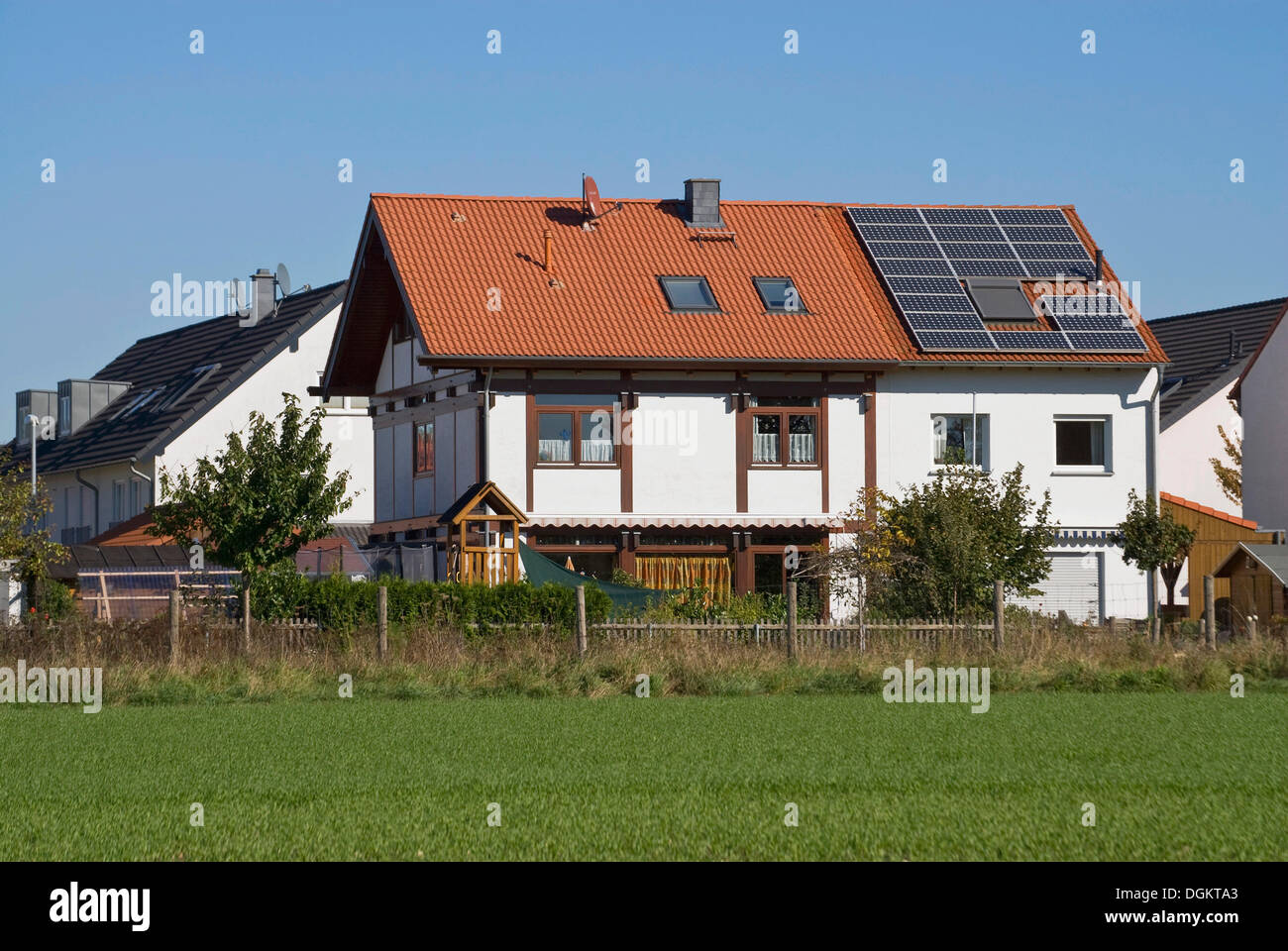 Multi-family house in a residential housing development with solar panels on the roof, PublicGround - Stock Image