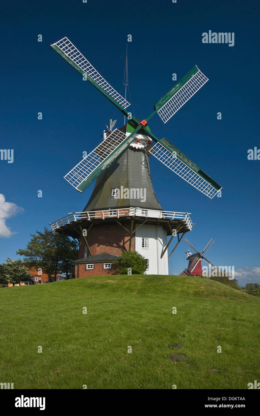 Twin windmills of Greetsiel, Dutch gallery windmill, western windmill at front, tea rooms, Krummhoern, landmark of Greetsiel - Stock Image