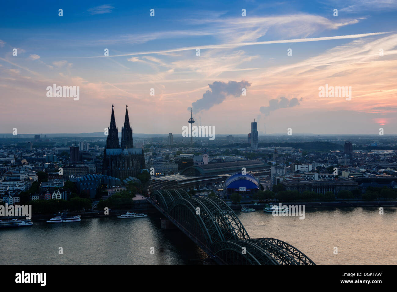 Cologne in the evening, dusk, view of Deutz Bridge, old town, Koelner Dom, Cologne Cathedral, Colonius and the Cologne Opera - Stock Image