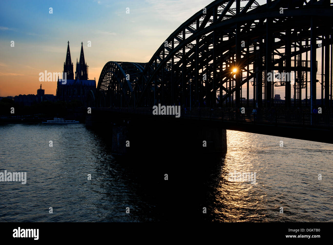 Koelner Dom, Cologne Cathedral and Deutz Bridge, silhouette, Cologne, North Rhine-Westphalia - Stock Image