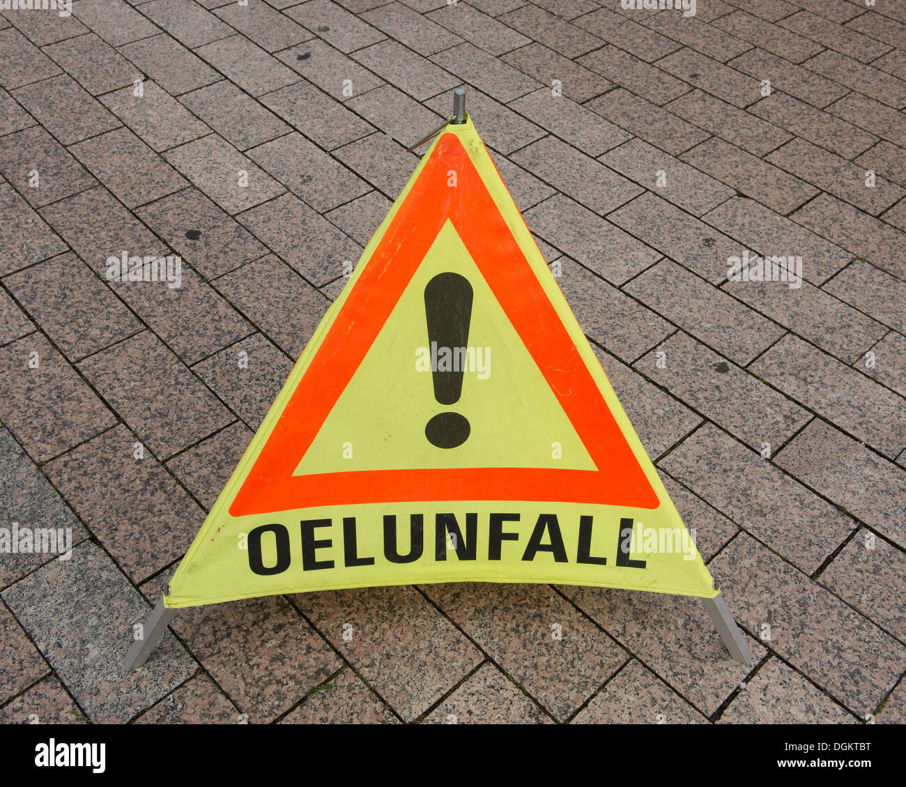 Warning triangle, folding triangle, with reference to 'Oelunfall', German for oil spill - Stock Image