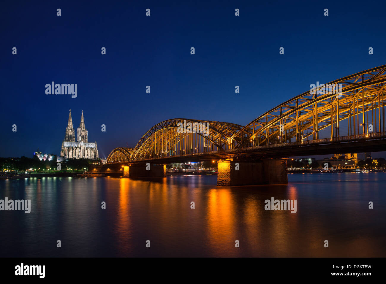 View from Cologne-Deutz to the Wallraf-Richartz-Museum, Koelner Dom, Cologne Cathedral and the Deutz Bridge, at night, Cologne - Stock Image