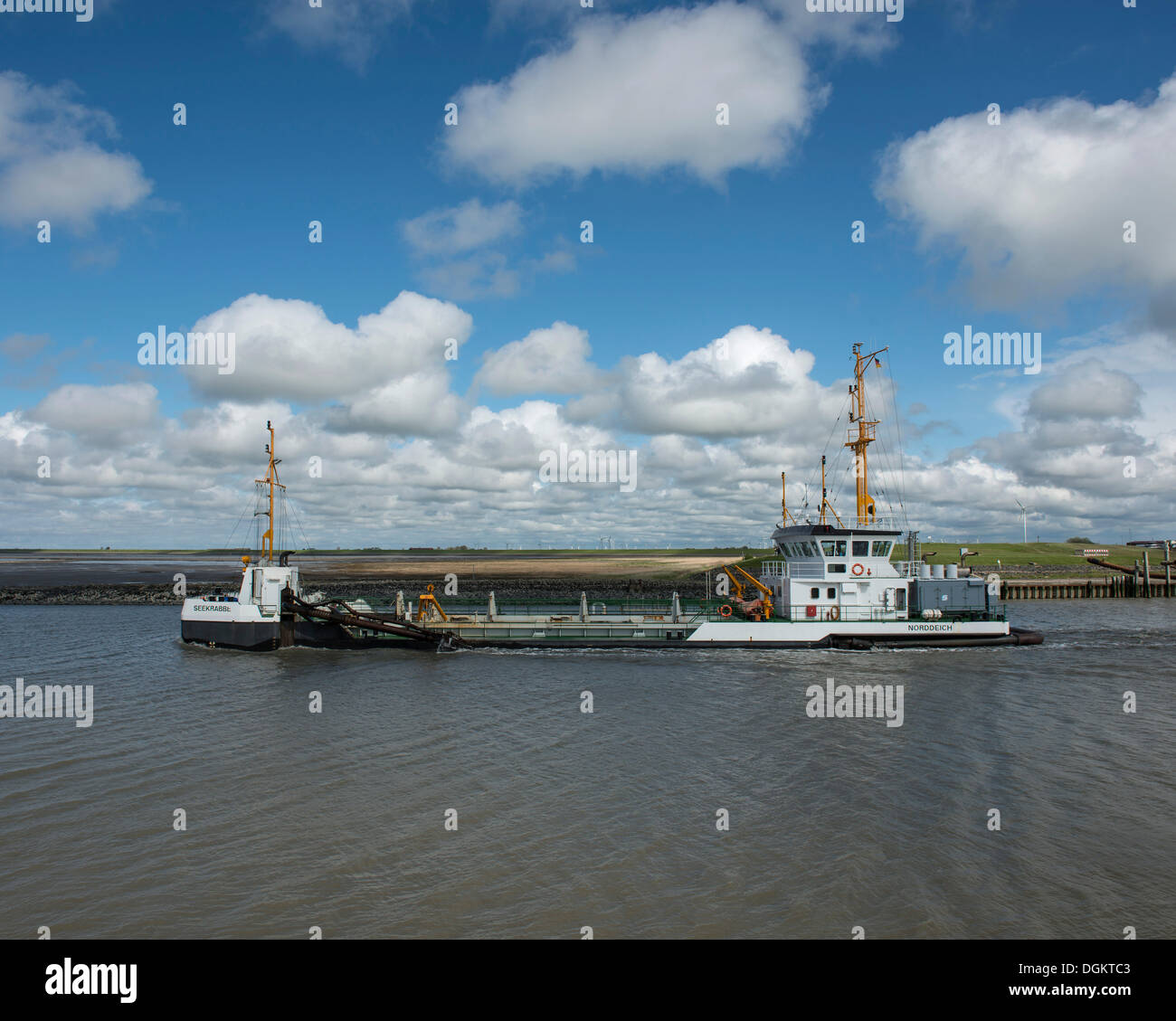 Hopper dredger, Seekrabbe, at the port entry of Norddeich, Lower Saxony Wadden Sea - Stock Image