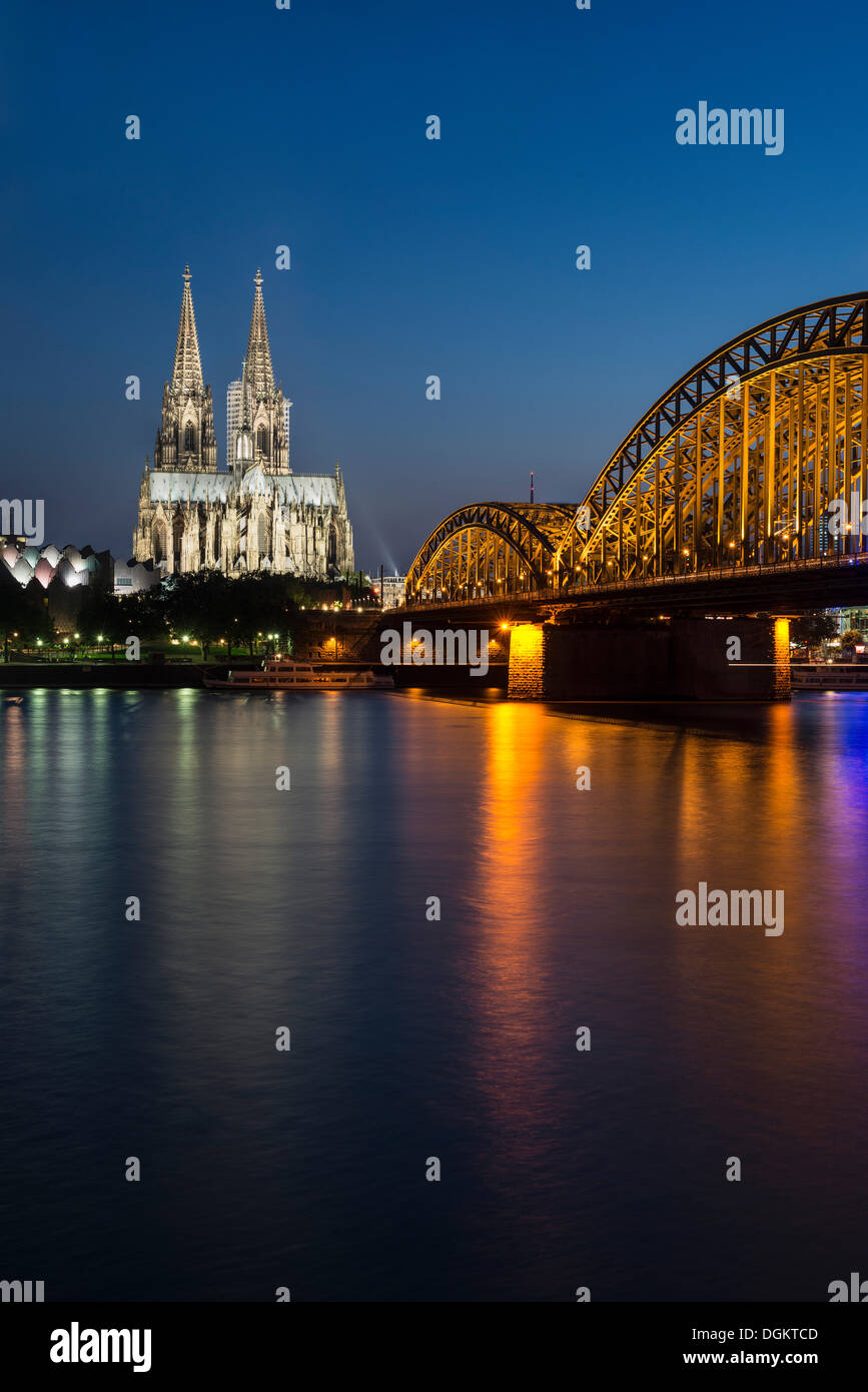 Evening view over the Rhine River towards Museum Ludwig, Cologne Cathedral and Hohenzollern Bridge, UNESCO World Heritage Site - Stock Image