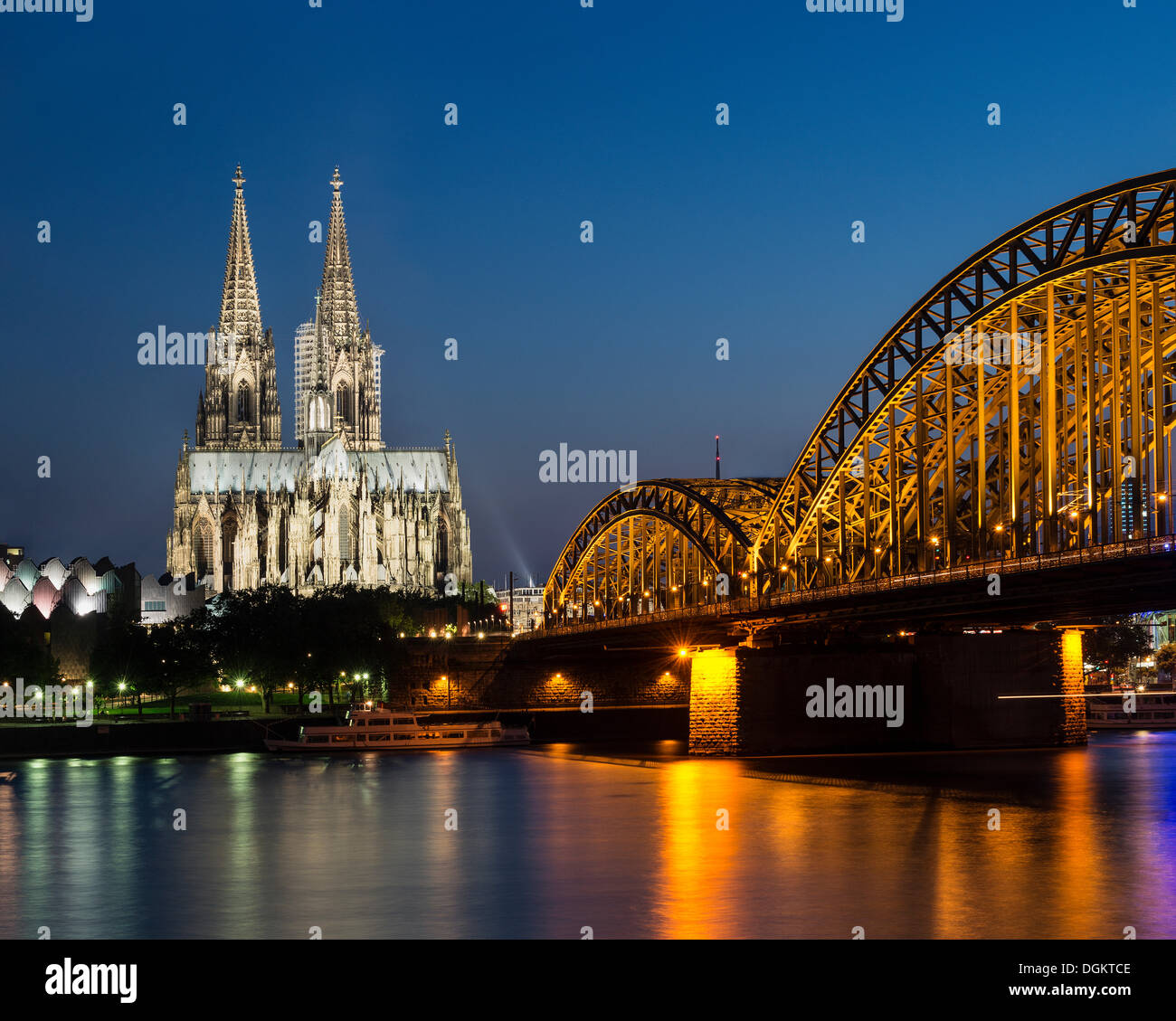 View across the Rhine River towards Museum Ludwig, Cologne Cathedral and Hohenzollern Bridge, North Rhine-Westphalia - Stock Image