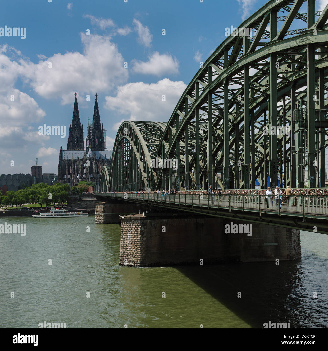 View across the Rhine River towards Cologne Cathedral and Hohenzollern Bridge, North Rhine-Westphalia - Stock Image