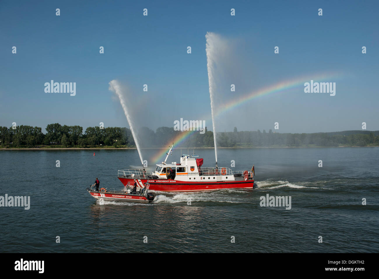 Fire drill of the Bonn fire brigade, a fire fighting boat with 3 fountains, accompanied by a smaller fire fighting boat, Bonn - Stock Image