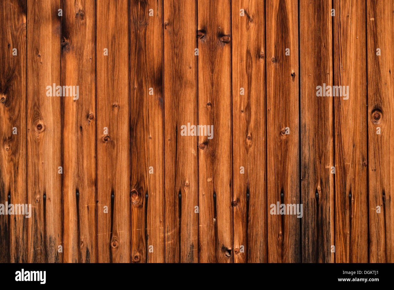 Wooden wall with weathering, background - Stock Image