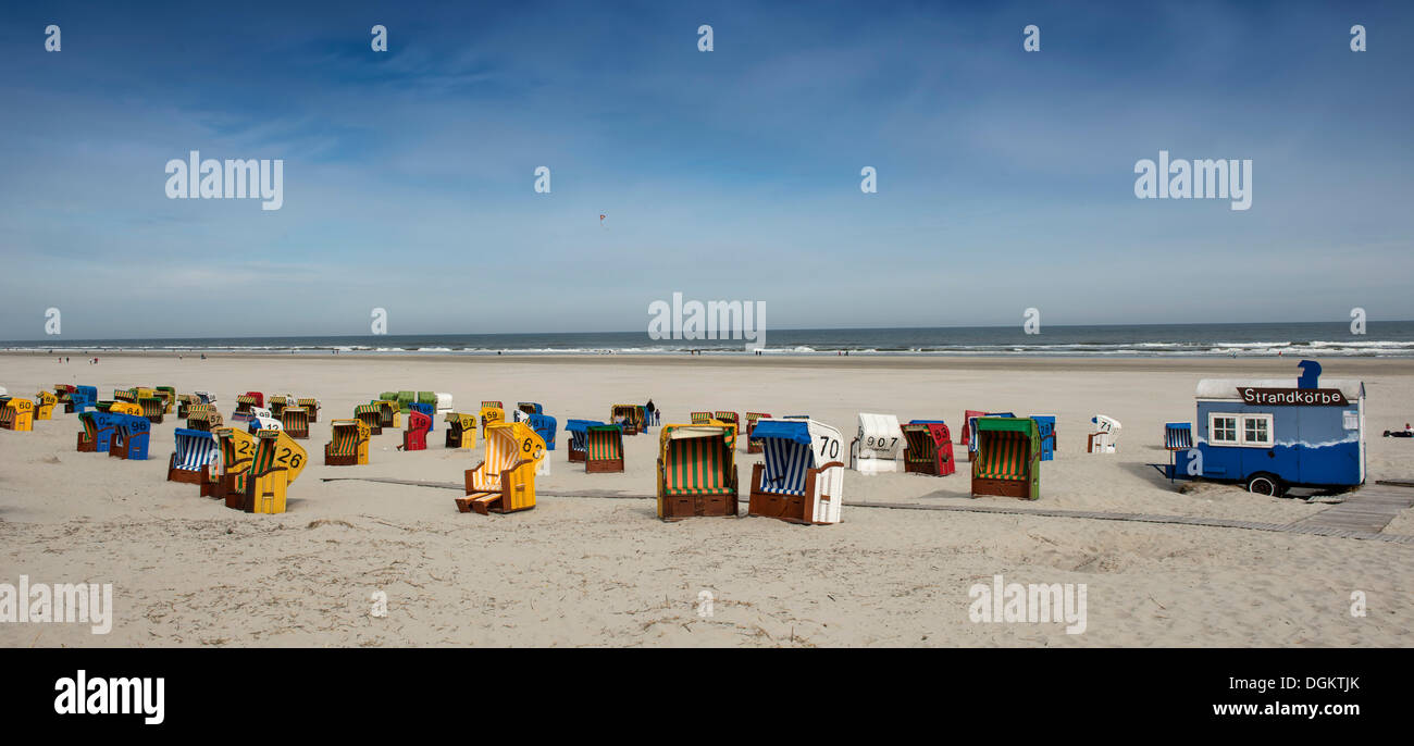 Panoramic view of the beach, roofed wicker beach chairs on the beach of Juist island, North Sea, Lower Saxony Wadden - Stock Image