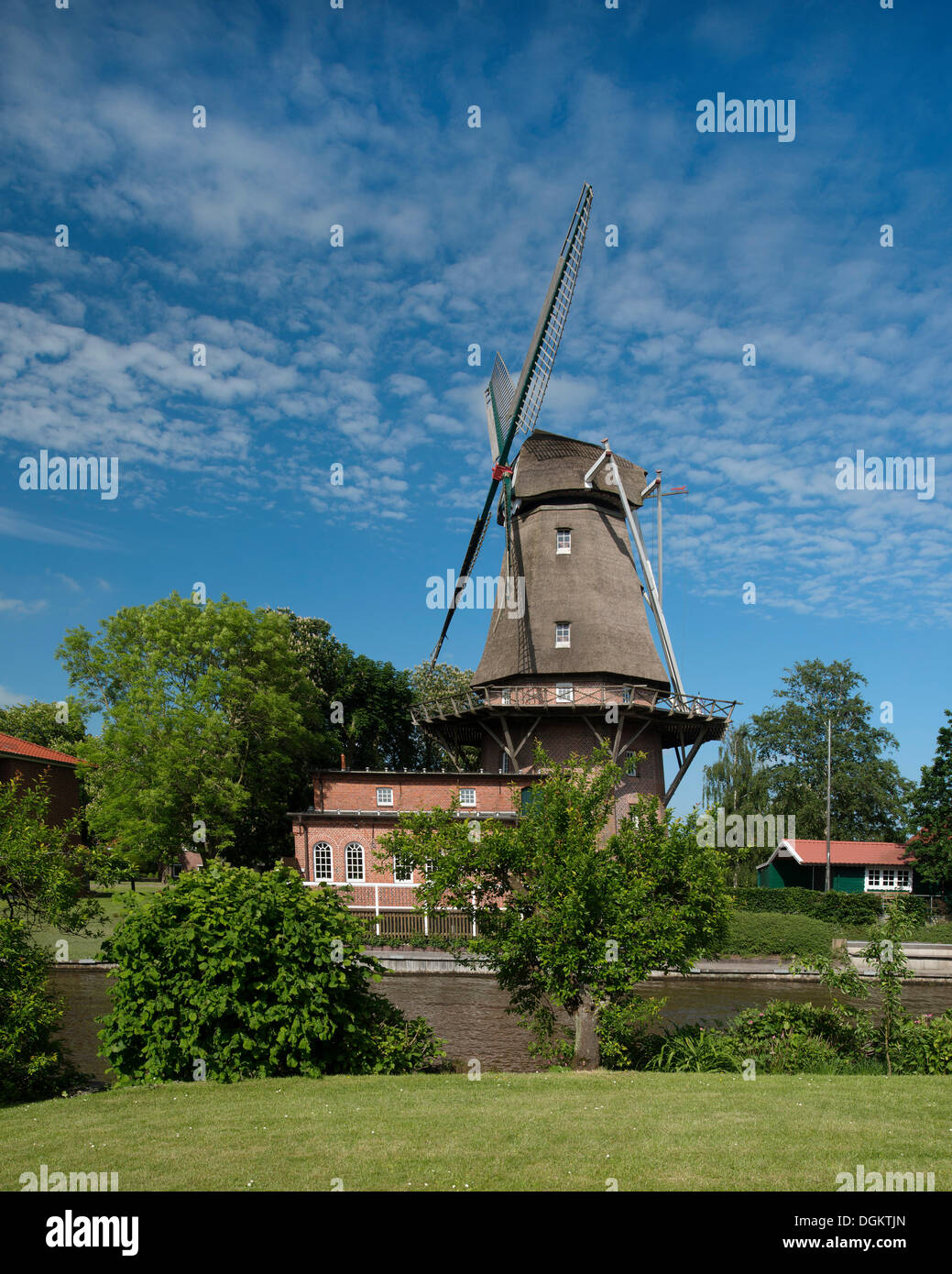 A Dutch three-storey windmill with a gallery, landmark of Hinte, East Frisia, Lower Saxony - Stock Image