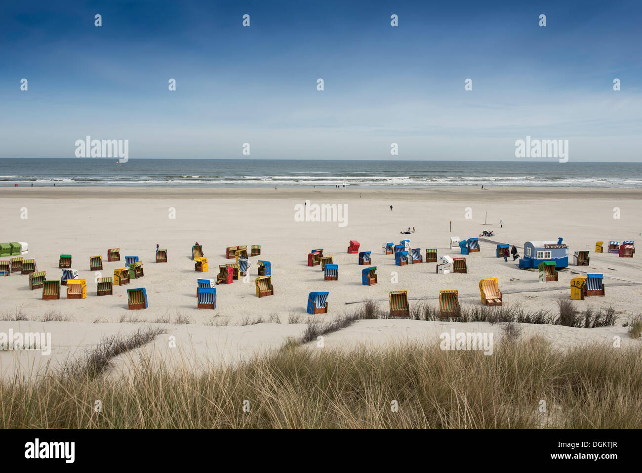 Roofed wicker beach chairs on the beach of Juist island, North Sea, Lower Saxony Wadden Sea, East Frisia, Lower - Stock Image